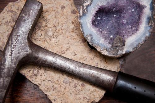 breaking open geode with hammer